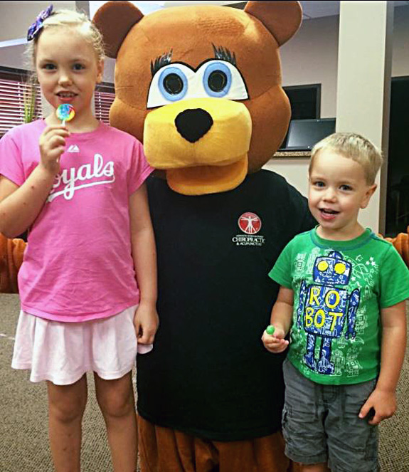 kids with Baxter the bear