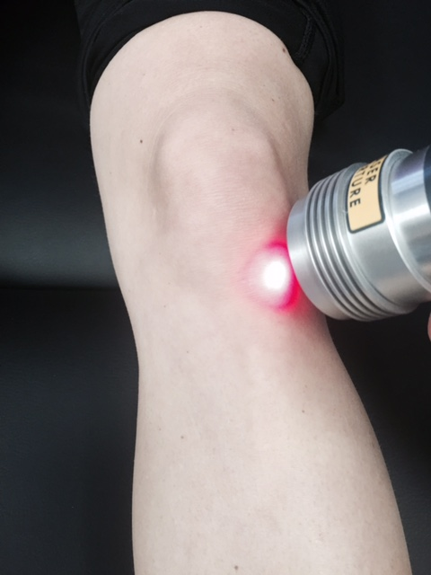 Cold Laser Therapy being used on a knee